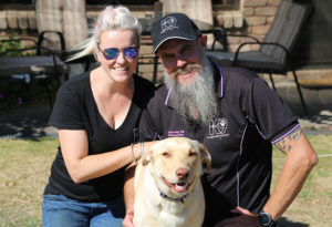 labrador dog with dog trainers cat saunders and brent dry from the k9 company