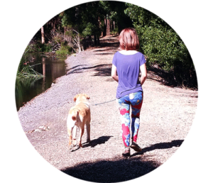 girl walking with yellow labrador dog